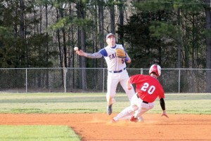 RWA shortstop Cameron Cooper steps on the bag, avoids the slide and turns the double play against Great Falls. (Photo/Martha Ladd)