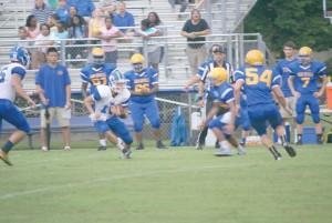 Gunnar Hensley (10) scrambles into the open field. (Photo/Kay Hensley)