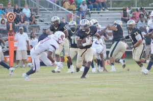 Jerrell Suber-Oneal (22) outflanks Chester's Quay Strong on his way to the first down. (Photo/DeAnna Robinson)
