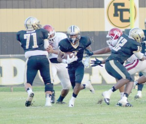 Josh Bell breaks through the line in the first half of play Friday. (Photo/DeAnna Robinson)