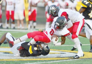 Sophomore wide receiver Montre Miller (6) is taken down near mid-field in Saturday's jamboree in Irmo. (Photo/Ross Burton)