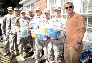 These National Guardsmen showed up Tuesday morning at the Christian Assistance Bridge to help load cases of water for families in the community picking up food and water from the CAB office on Blythewood Road. At right is CAB board member Ken Trogden. (Photo/Barbara Ball)