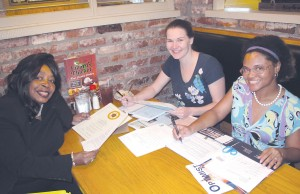 At work in their 'office' at Lizard's Thicket in Blythewood, Optimists Lola Cumbo, Keri Boyce and Sierra Kelly plan their club's first banquet set for Saturday night at Round Top Baptist Church. (Photo/Barbara Ball)