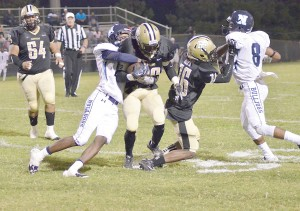 Tony Ruff (29) grinds out a run against Newberry Friday. (Photo/DeAnna Robinson)