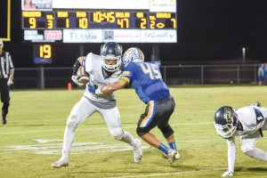 Jacob McGuire takes a David Isreal pass and fights for yards. (Photo/Kristy Kimball Massey)