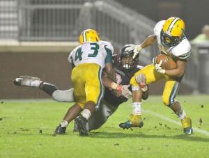 Malik Horton (9) gets the stiff-arm from Spring Valley's Tyjuan Fulton. (Photo/Ross Burton)