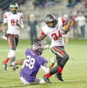 Rudy Mitchell (34) shakes a Northwestern tackle. (Photo/Ross Burton)