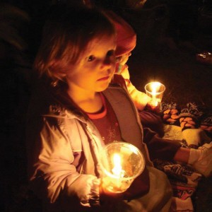 Emma McIntyre lets her little light shine warmly during a chilly Christmas Eve in the Fields.
