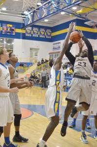 Akyel Richmond (23) draws the foul underneath the basket at Lexington Monday. (Photo/DeAnna Robinson)