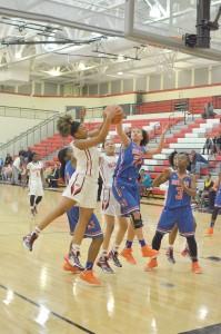 Maliyah Lockett (11) battles for the rebound. (Photo/DeAnna Robinson)