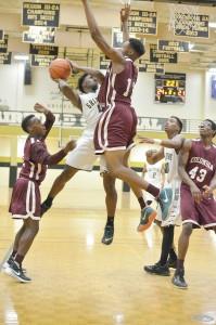 Brandon Adams (4) goes hard to the basket. (Photo/DeAnna Robinson)