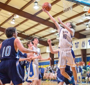 Cooper Swearingen (10) with the reverse layup Tuesday for RWA. (Photo/Ross Burton)