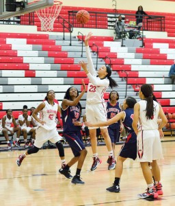Maya Belton (23) drops one in for the Lady Redhawks. (Photo/Ross Burton)