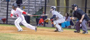 Deuntrey Gallman strokes an RBI single into center. (Photo/Ross Burton)