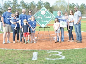 Richard Winn Academy officially dedicated its baseball field in honor of the late Billy Ladd, who passed away Feb. 26. Ladd was a fixture for many years of RWA athletics, particularly Eagles baseball. In a ceremony before last Friday's game with Fairfield Central, members of the Ladd family gather around home plate for the dedication. From left are: James Sims, Callie Ladd Sims holding Anne Lightcap, Jamie Lightcap, Simon Lightcap, Frances Ladd Lightcap, Lucy Lightcap, Bella Lightcap, Martha Ladd, Meg Ladd holding Sophie Lightcap and William Ladd.(Photo/DeAnna Robinson)