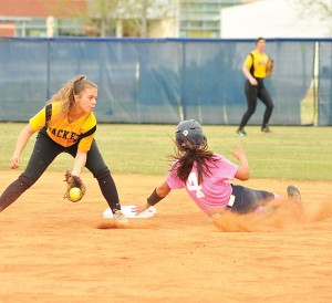 Maggie Herrera (4) slides safely into second during game 1 Friday. (Photo/DeAnna Robinson)