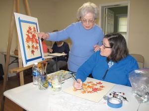 Instructor Kitty Rabb of Winnsboro instructs Sharon Swofford of Ridgeway in watercolor technique. (Photo/Barbara Ball)