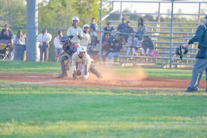 Fairfield Central's Chris Simmons looks for the call after sliding safely into home against Columbia Tuesday. (Photo/Ross Burton)