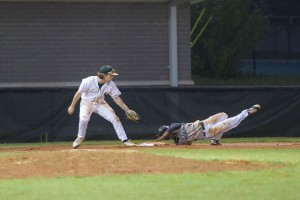 Blythewood's Jordan Flemming takes a tumble going hard into third Monday at Spring Valley. (Photo/Kristy Kimball Massey)