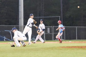 Bengals pitcher Collin Miller ducks as Todd Mattox makes the throw across the diamond to first and Justin Greider covers third during Blythewood's Diamond Invitational game vs. J.L. Mann. (Photo/Kristy Kimball Massey)