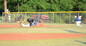 Gunnar Hensley tangles with Wardlaw Academy's first baseman Tuesday diving back to the bag. (Photo/Ross Burton)