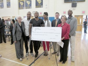 Blythewood High School graduate and NFL Pro-Bowl defensive back Justin Bethel presented a check for $100,000 to the Blythewood High School Education Foundation on Friday. Shown with Bethel are Dr. Sharon Buddin, Chairwoman of the BHS Education Foundation; Gabriel Bethel (brother); Brenda Bethel (mother); Dr. Keith Price, Richland School District 2 Assistant Superintendent, BHS Principal Brenda Hafner and BHS Athletic Director Vince Lowry. (Photo/Barbara Ball)