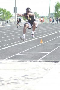 Akyel Richmond takes the top spot in the long jump. (Photo/DeAnna Robinson)