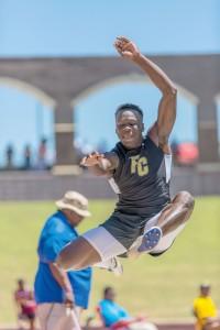 Fairfield Central's Akyel Richmond takes the Class 2A state title in the boys long jump. (Photo/Jason Arthur)