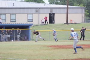 Coker Gilbert runs down Wardlaw's Britt Gosset from third in the fifth inning of game 1 Monday. (Photo/Kay Hensley)
