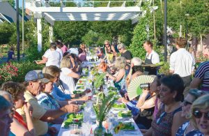 Around 75 people gathered for dinner last week on the promenade behind the Town Clock.