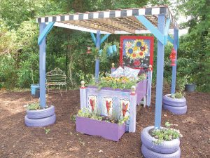 This whimsically painted 'flower bed' made from discarded items, was featured in artist Christy Buchanan's painted garden during Fairfield County's Ag & Art Tour last year.