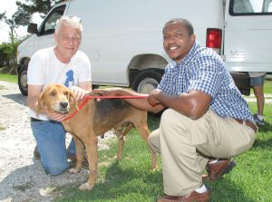 Bob Ennis, Shelter Manager for Pets, Inc. and new Fairfield County Animal Shelter Director James Hill with one of 29 dogs taken from the Fairfield shelter in the last 10 days by two rescue organizations, Pets, Inc. and Ozzie to the Rescue, and placed in safe havens where they will receive shots, be altered and cared for until they can be adopted. Clearing of the dogs from the shelter was facilitated by The Hoof and Paw Benevolent Society.