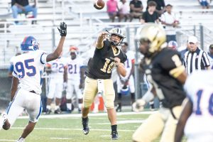 Fairfield Central QB Stanley McManus (10) unloads ahead of pressure from the RNE defense. (Photo/Kristy Kimball Massey)