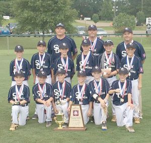 The Blythewood Minors – front: Ryan Watts, Landon Smith, Sammy Franklin, Jackson Bottar, Alex Myers, Evan Todd; middle: Landon Penfield, Jeb Britt, Miller Stuck, Jack Sanderson, Harrison Collins, John Rollings; back: coaches Ken Britt, Les Penfield and Buzzy Myers.