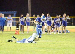 Jake Clyburn (5) slips a tackle vs. Newberry Academy Friday. (Photo/Martha Ladd)