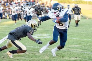 Blythewood's Kameron Riley (6) slips the tackle attempt by Quay McBride (11) and takes Jordyn Adams' pass in for the score. (Photo/Kristy Kimball Massey)