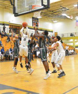 J.R. Edmonds (10) draws a crowd underneath the net. (Photo/Joe Seibles)