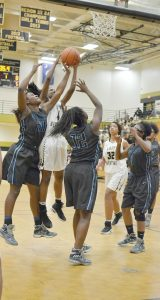Tahalier Collier (4) puts one up underneath for the Lady Griffins. (Photo/DeAnna Robinson)