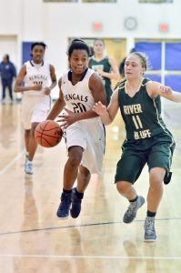 Alexis Mims (20) works the ball down court Friday. (Photo/Kristy Kimball Massey)