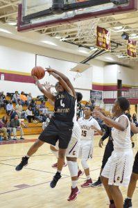 Tahalier Collier (4) battles for the rebound. (Photo/DeAnna Robinson)