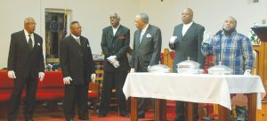 Serving Communion during the Night Watch are Deacons Clifton Hendrix, Clarence Lyles, Lawrence Coleman, John Peoples, Thomas Coleman and the Rev. Eric Bell. (Photo/Clifton Hendrix)