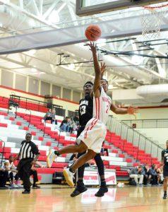 Russell Jones (2) shows his reach under the basket. (Photo/Ross Burton)