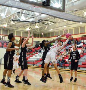 Maya Belton (23) fights for the rebound. (Photo/Ross Burton)
